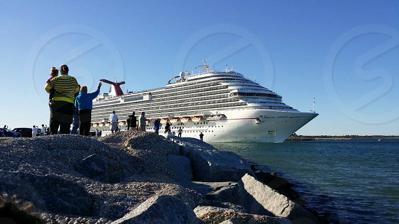 Cruise ship sailing from port photo