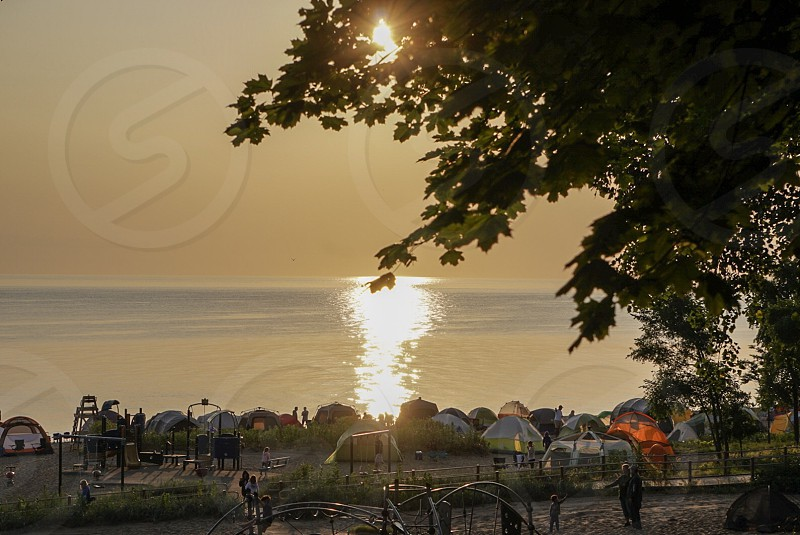 Sunrise; camping; beach; summer break; summer; tents; family event ; Lake Michigan; Illinois; Chicago; morning; Midwest  photo