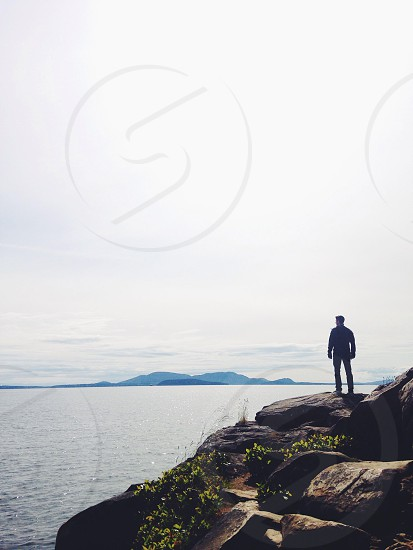 man standing by the cliff photo