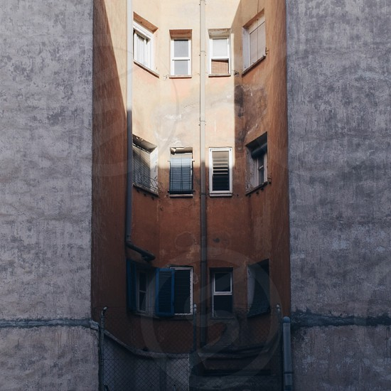 photo of gray and brown concrete multi-story building photo