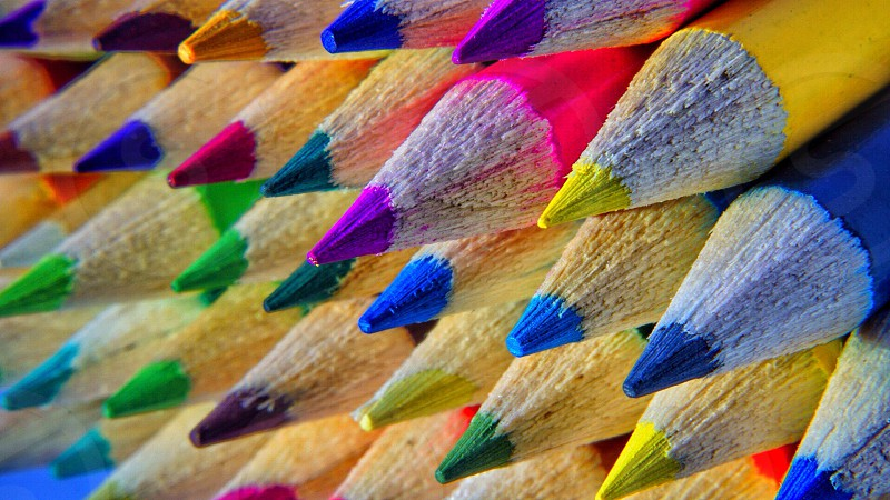 sharpened color pencils stacked close up photo