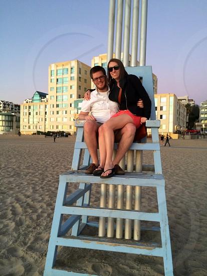 Couple in a lifeguard chair in Santa Monica photo