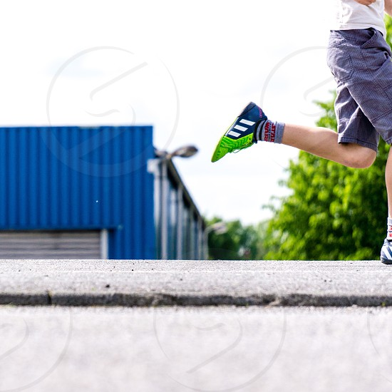 Young Boy Running out of scene  photo