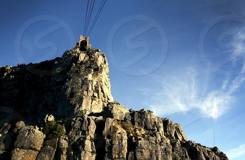grey mountain cliff photograph  photo