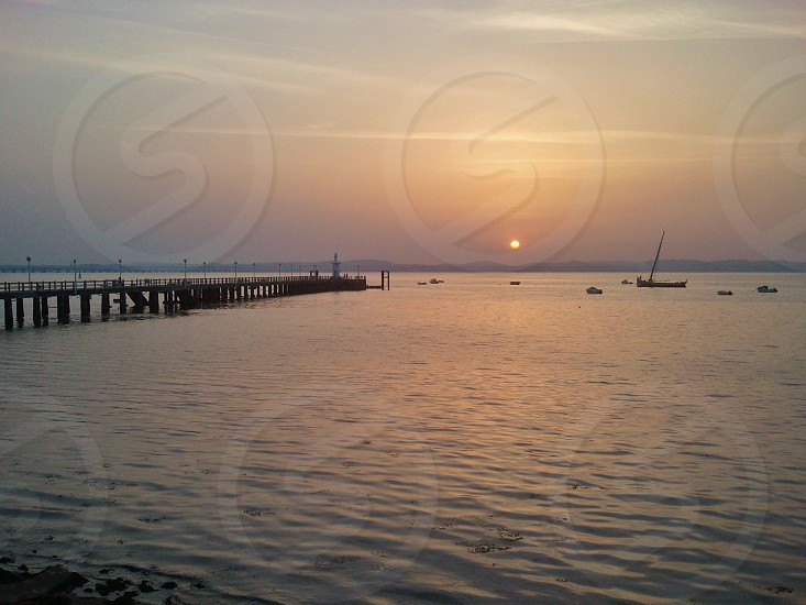 sunset river Tagus boat pier photo