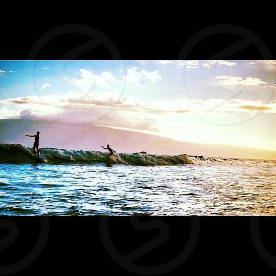 2 men in ocean photo