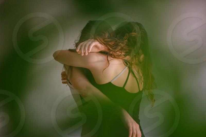 two girls hug and dance move photo