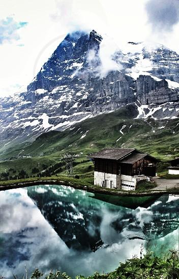 house beside a snowy mountain photo