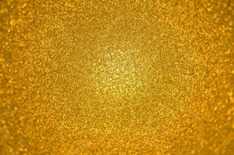 Glistening Gold Colored Small Particles Closeup photo