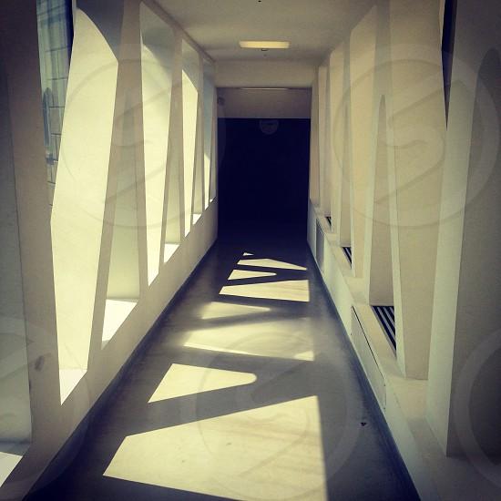 white concrete hallway during daytime photo
