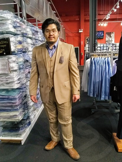 Man suit shopping fitting business attire photo