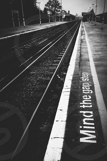 Waiting. Train station England UK mind the gap rail railway. photo