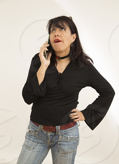 woman talking phone with anger and surprised attitude on white background photo