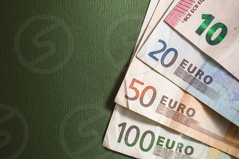 Contemporary euro banknotes on green background.  photo