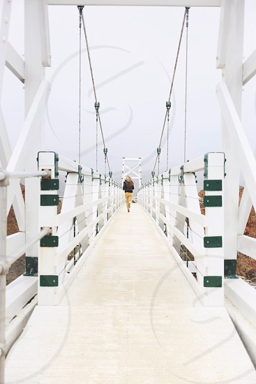 white wood bridge with green posts photo