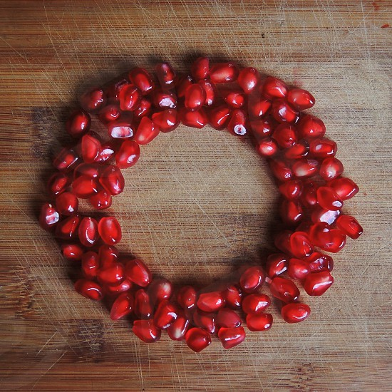 red pomegranates seeds forming circle photo