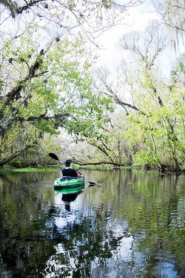 Kayking snake creek near Blue Springs FL adventure wanderlust nature travel outdoors vertical one man Caucasian trees river freshwater   photo
