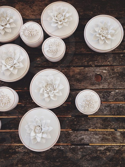 white floral designed candle photo