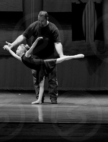 Daddy daughter dancing girl man dad dance performance kid child recital father leotard photo