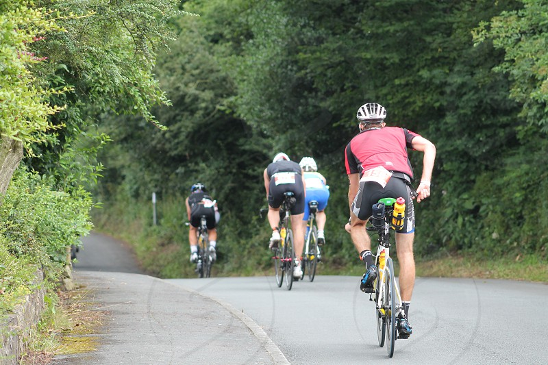 Cyclist moving fast in the Iron Man Race Lancashire United Kingdom photo