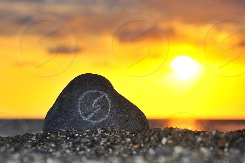 view of sunset and gray stone pebble photo