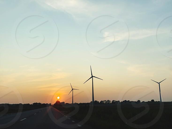 Silhouette  silhouettes sunset  power wind power  road landscape  sun sky photo