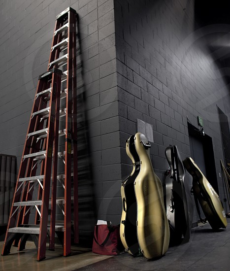 Ladders and cello cases backstage during symphony rehearsal. photo