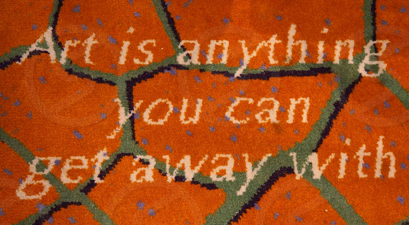 I saw this text on the carpet on the ferry from Hirtshals to Langesund Norway. I could not just walk over this one. :-) photo