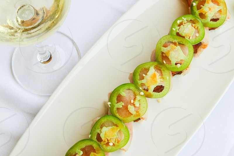Sushi roll and white wine overhead view  photo