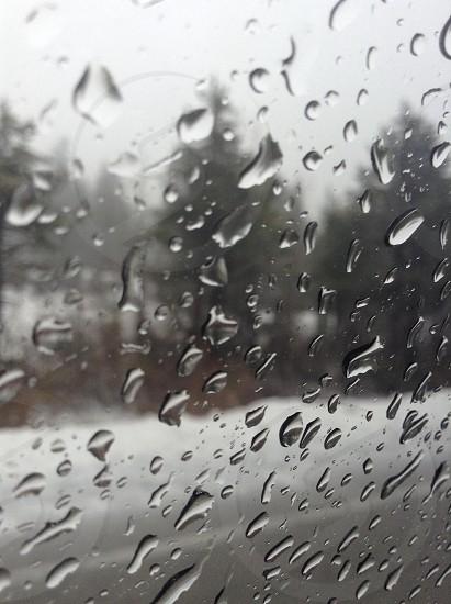 clear glass window with rain drops photo