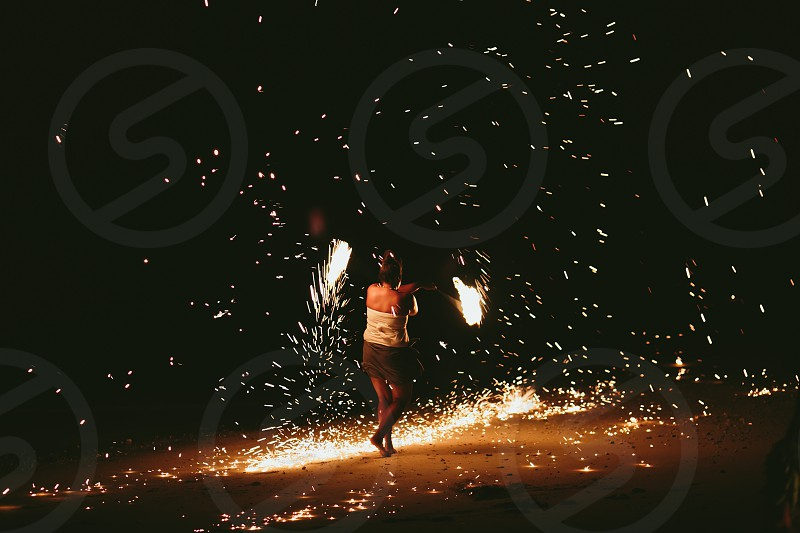 firedancer fire beach entertainment fiji south pacific smoke flame yellow orange night wedding party celebration  photo