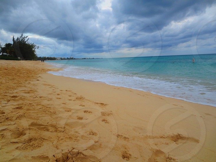 tan sand beach photo