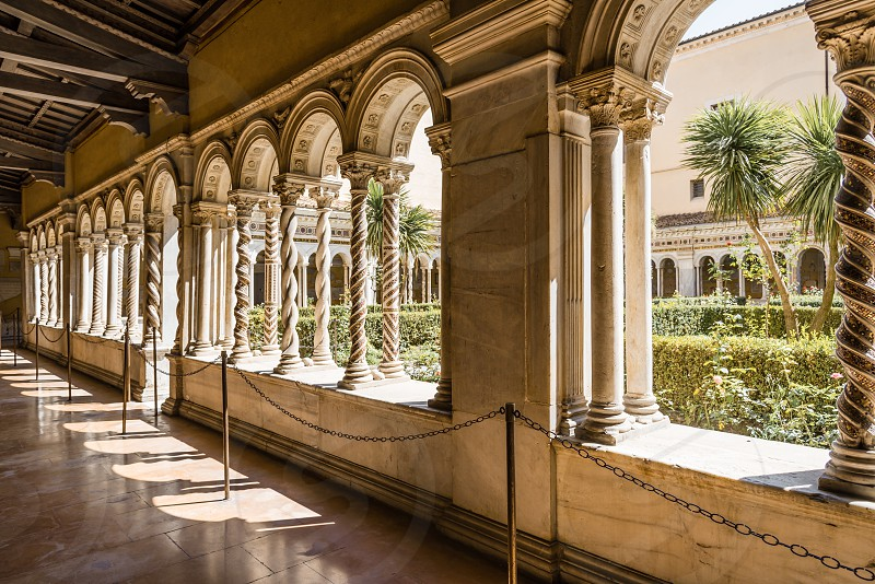 Cloister of the Papal Basilica of St. Paul outside the Walls . It is one of Rome's four  major basilicas. photo