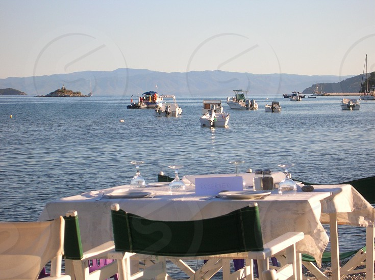 Table with a view sea dining table chairs boats summer photo
