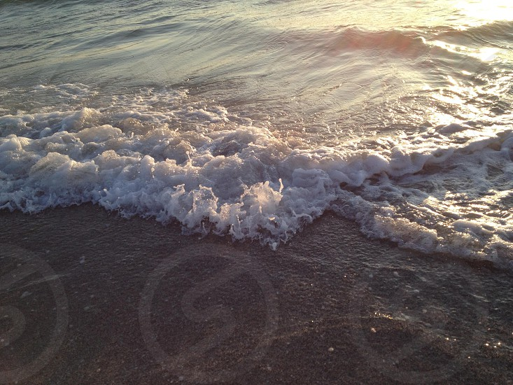 Waves roll in at Clearwater Beach FL. photo