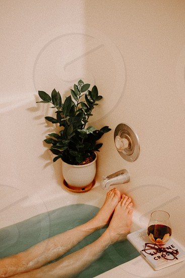My favorite way to relax? A little wine a lot reading and a soothing bath of course.   photo