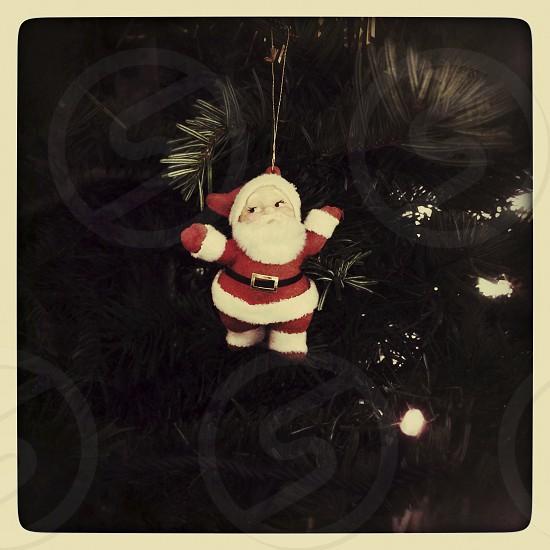 Santa ornament on a christmas tree photo