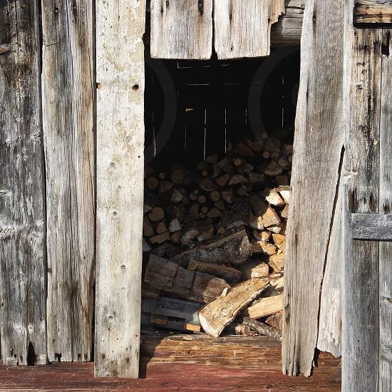 chopped wood inside wooden house photo