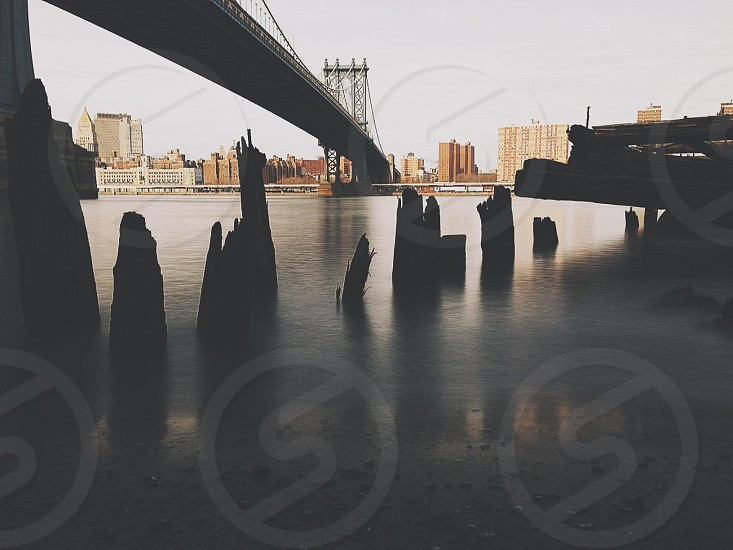 body of water under the bridge photo photo