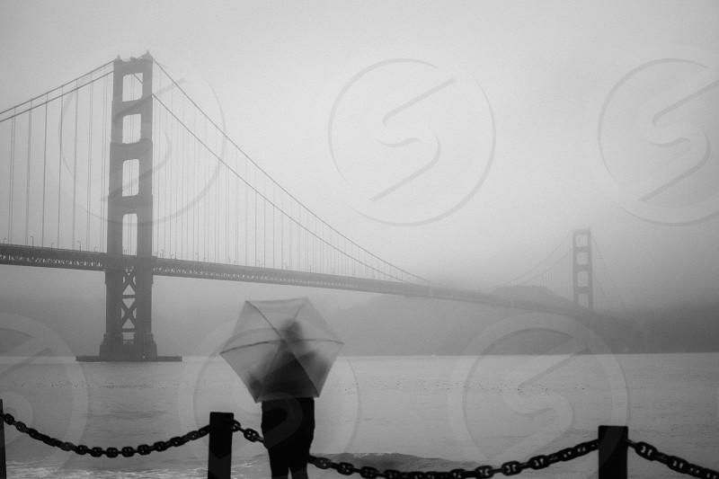 Rainy day tourist - Golden Gate Bridge San Francisco CA US photo