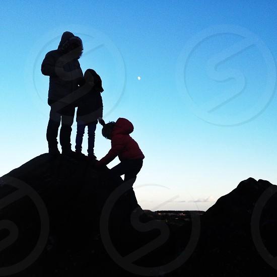 people on rocks in mountain photo