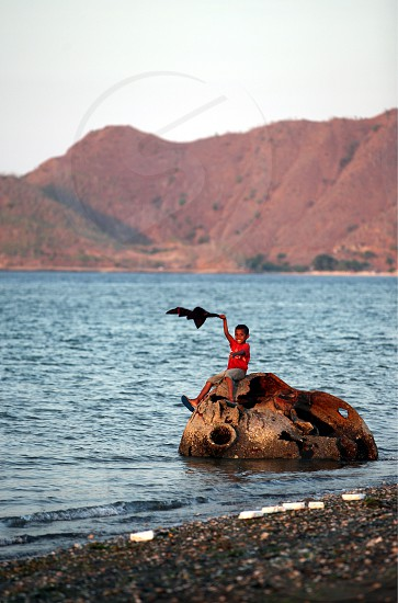 the coast and beach at thecity of Dili in the south of East Timor in southeastasia. photo