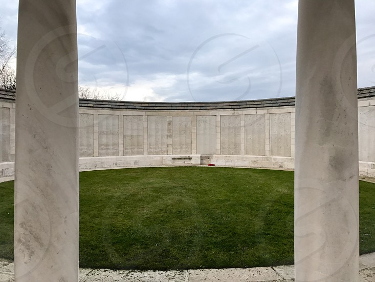 Outdoor day landscape horizontal colour Tyne Cot Cemetery Allied British Commonwealth graveyard graves gravestones memorial War remembrance white marble stone carved grass fields poppies countryside Ypres salient Europe European fields sky nature rest peace beauty silence wreath respect wall names photo