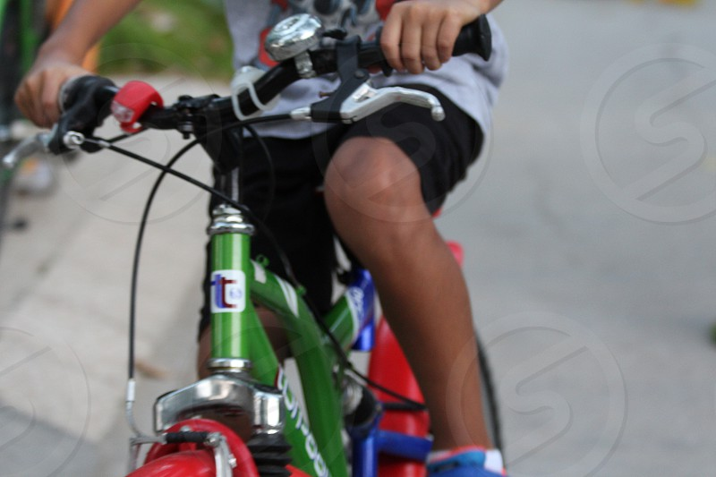 A kid on a bicycle at summer time photo