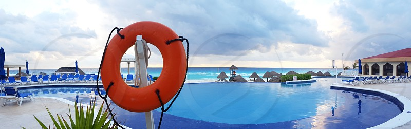 Mexico resort during vacation travel with pool and ocean view. photo