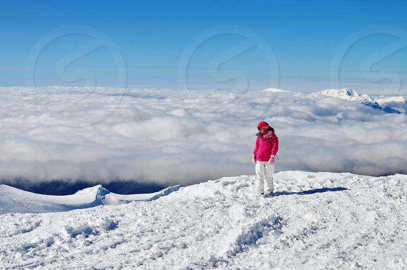 Excited woman discovering the beauty of the mountain photo