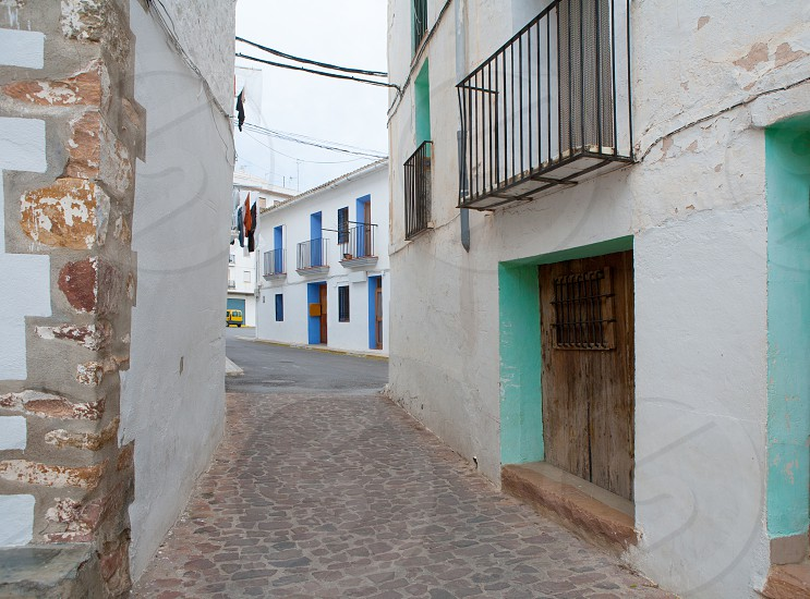 Ain village in Castellon whitewashed facades at Valencian community spain photo