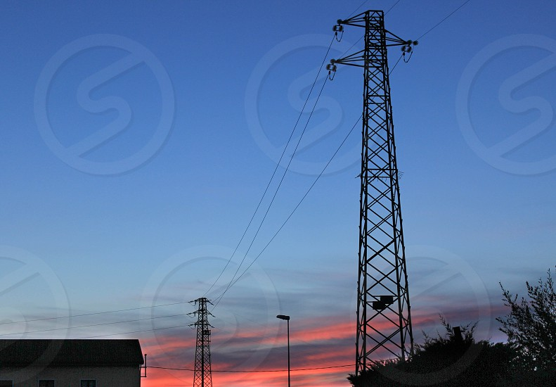 steel electric transmission line tower photo