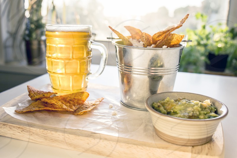 beer; glass; food; cheese; chips photo