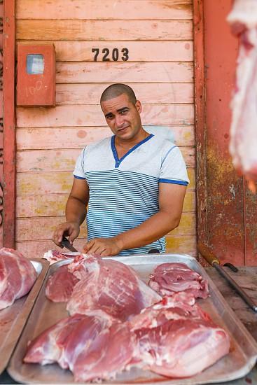 Butcher on a street in Cuba photo